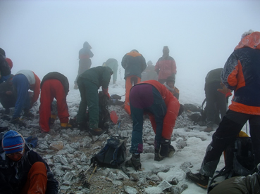 Mountaineers wear crampons before Mount Ararat summit push.